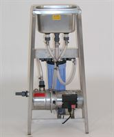 Twin nozzle rinser/steriliser sink with pump & filter housing