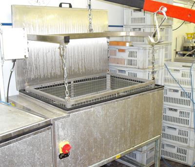 Large bottle basket being lifted out of in-bottle pasteuriser (available separately) by crane