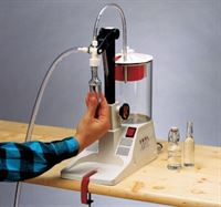Miniature bottle kit in use on Enolmatic vacuum filler (available separately)